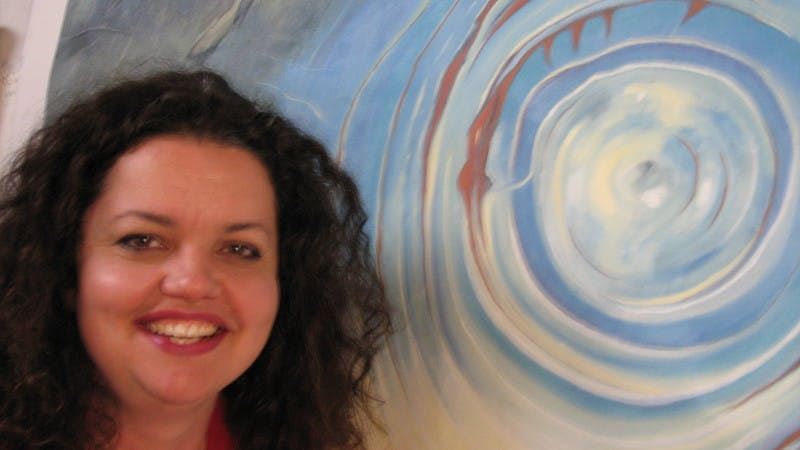 Leah, Arts and Culture Development Officer with art by Audrey Kooyman, Artist-in-residence